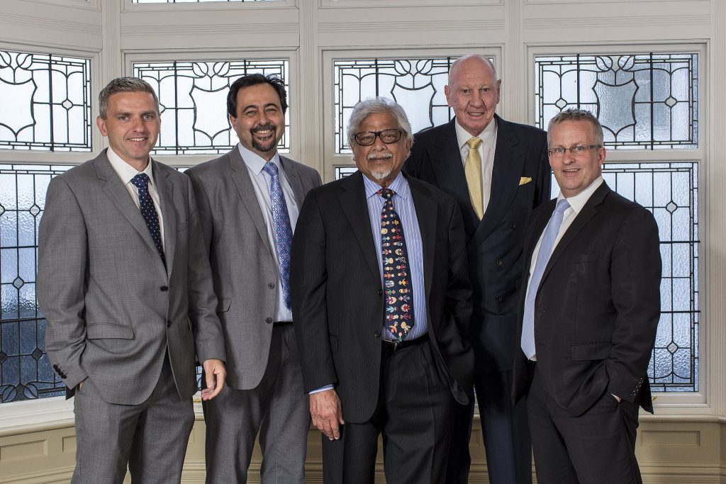 Donors to the Chair. Dr Adrian Johnston, Chair of the International Fund for Ireland (IFI), Professor Brandon Hamber (The John Hume and Thomas P. O'Neill Chair in Peace), Dr Arun Gandhi, E. Neville Isdell, inaugural donor and Ulster University honorary graduate and Professor Paddy Nixon (Vice-Chancellor, Ulster University). Photo: Nigel McDowell/Ulster University.